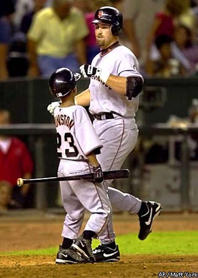 San Francisco Giants' Rich Aurilia is congratulated by bat boy Shawon Dunston Jr. after hiting a two-run home run against the Arizona Diamondbacks during the fifth inning at Bank One Ballpark in Phoenix Saturday, July 28, 2001.(AP Photo/Matt York) Photo: MATT YORK