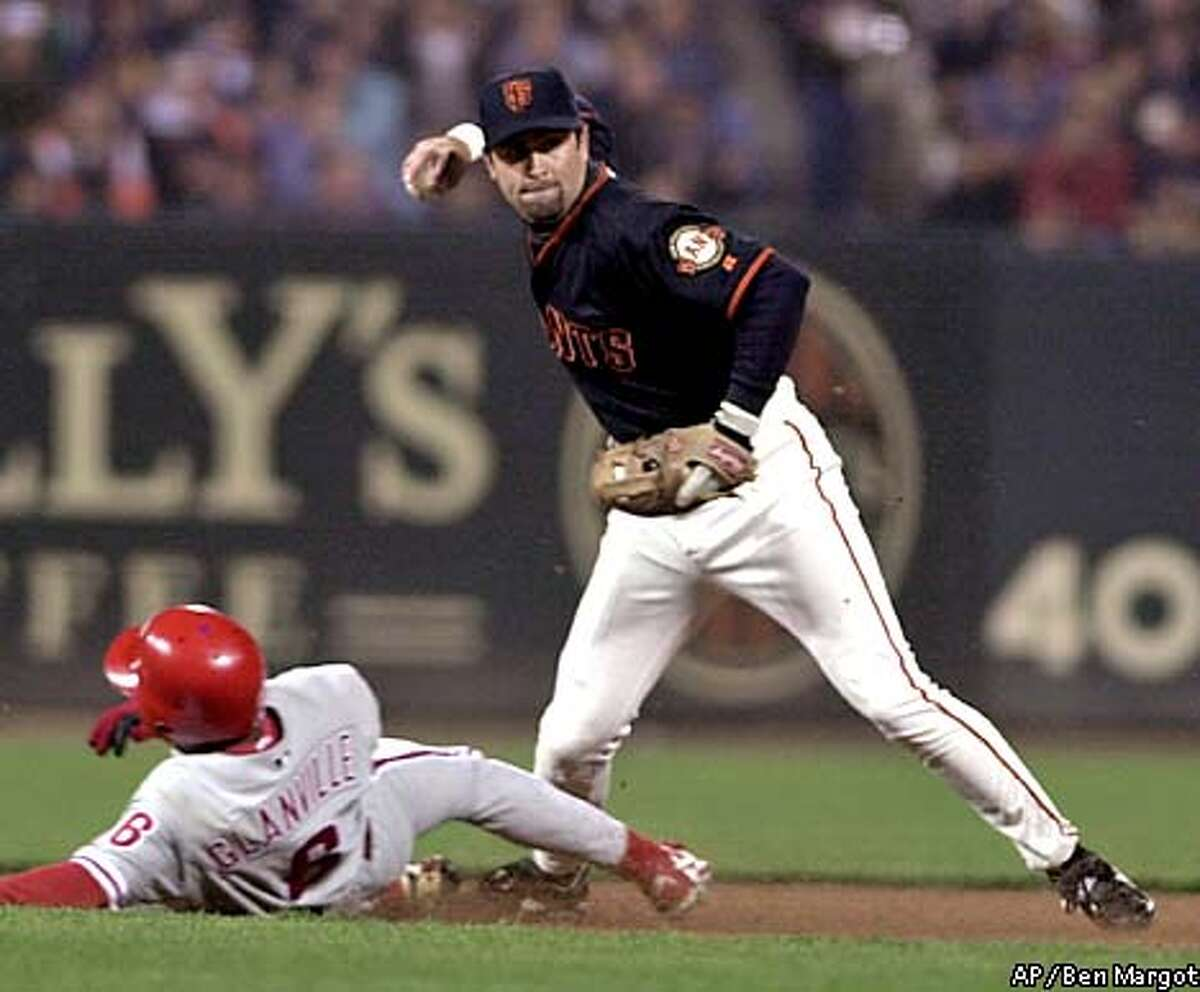 San Francisco Giants' Rich Aurilia throws over Philadelphia Phillies' Doug Glanville to complete a double play in the fourth inning Friday, Aug. 3, 2001, in San Francisco. Johnny Estrada was out at first base. (AP Photo/Ben Margot)