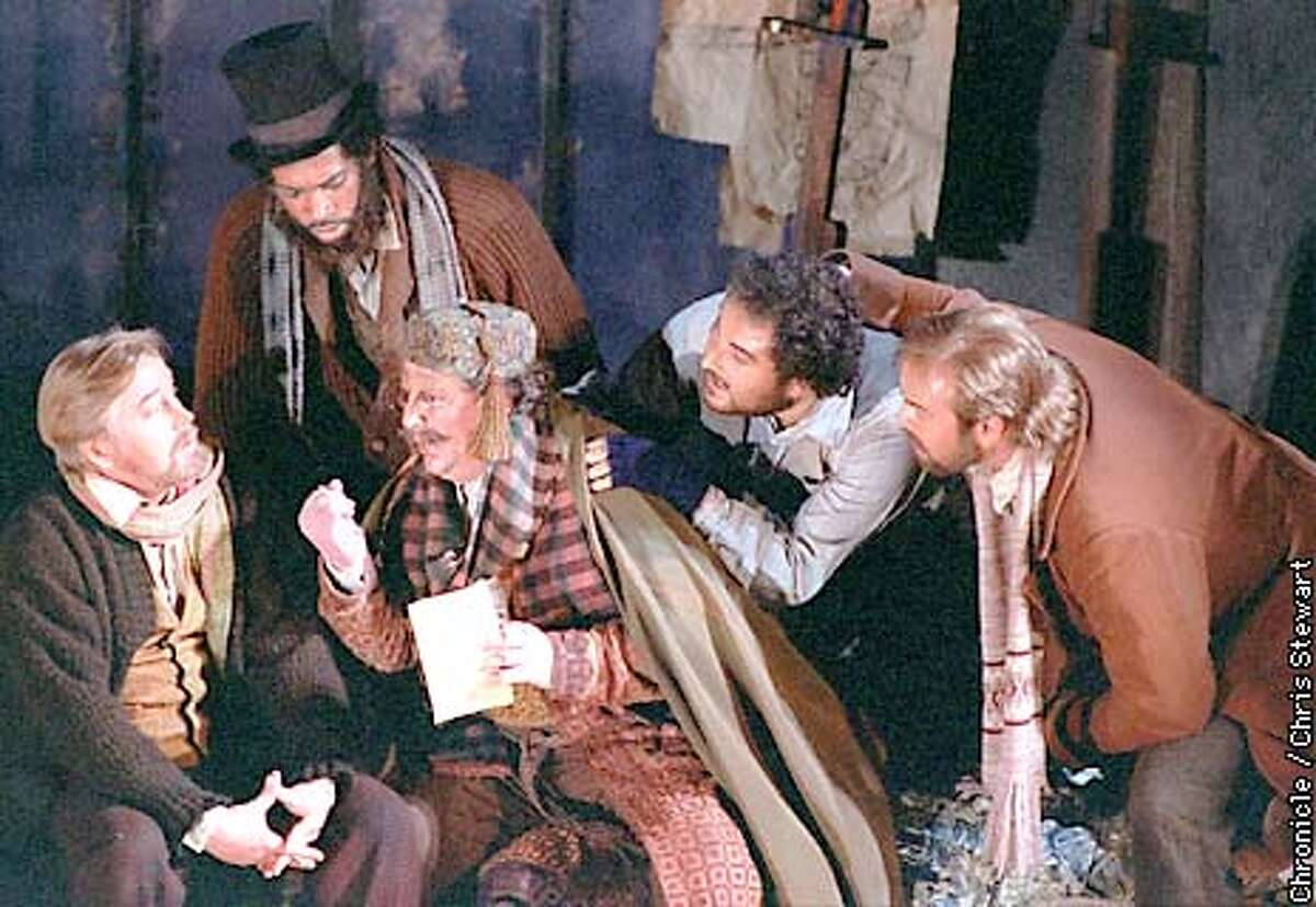 """Four Boh�mian artists attempt to bamboozle their landlord Benoit, portrayed by Peter Strummer (C). (L-R) Victor Ledbetter as Marcello; Chester Patton as Colline; Strummer as Benoit; Roberto Aronica as Rodolfo and David Okerlund as Schaunard in Act I of Giacomo Puccini's """"La Boh�me,"""" being produced by the SF Opera. SAN FRANCISCO CHRONICLE PHOTO BY CHRIS STEWART"""