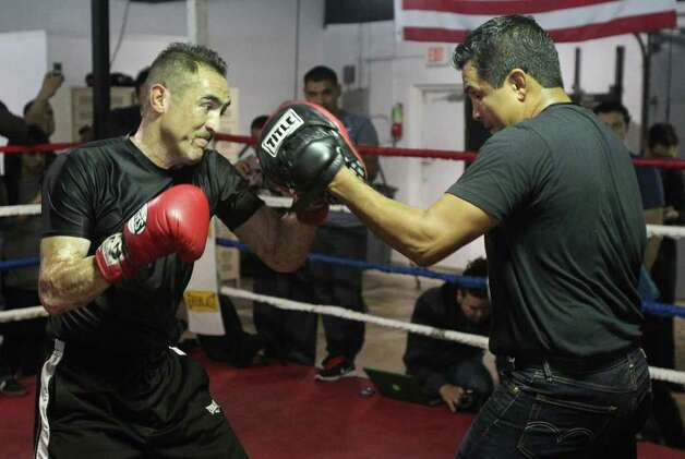 Boxer Marco Antonio Rubio (left) spars with trainer Jorge Rodriguez (right) at Championfit Gym ahead of his championship bout against Julio Cesar Chavez Jr. on Saturday. Photo: John Davenport, Jdavenport@express-news.net