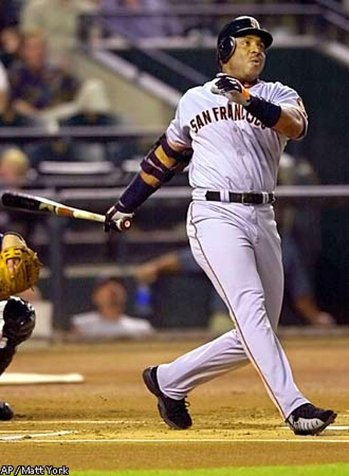 San Francisco Giants' Barry Bonds blasts his 45th home run of the season during the fourth innning against the Arizona Diamondbacks at Bank One Ballpark in Phoenix Friday, July 27 2001. (AP Photo/Matt York)