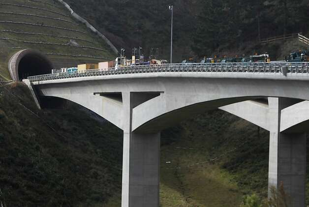 Construction vehicles are parked on the bridge leading from the northbound Devil's Slide tunnel project in Pacifica on Jan. 31, 2012. Photo: Paul Chinn, The Chronicle