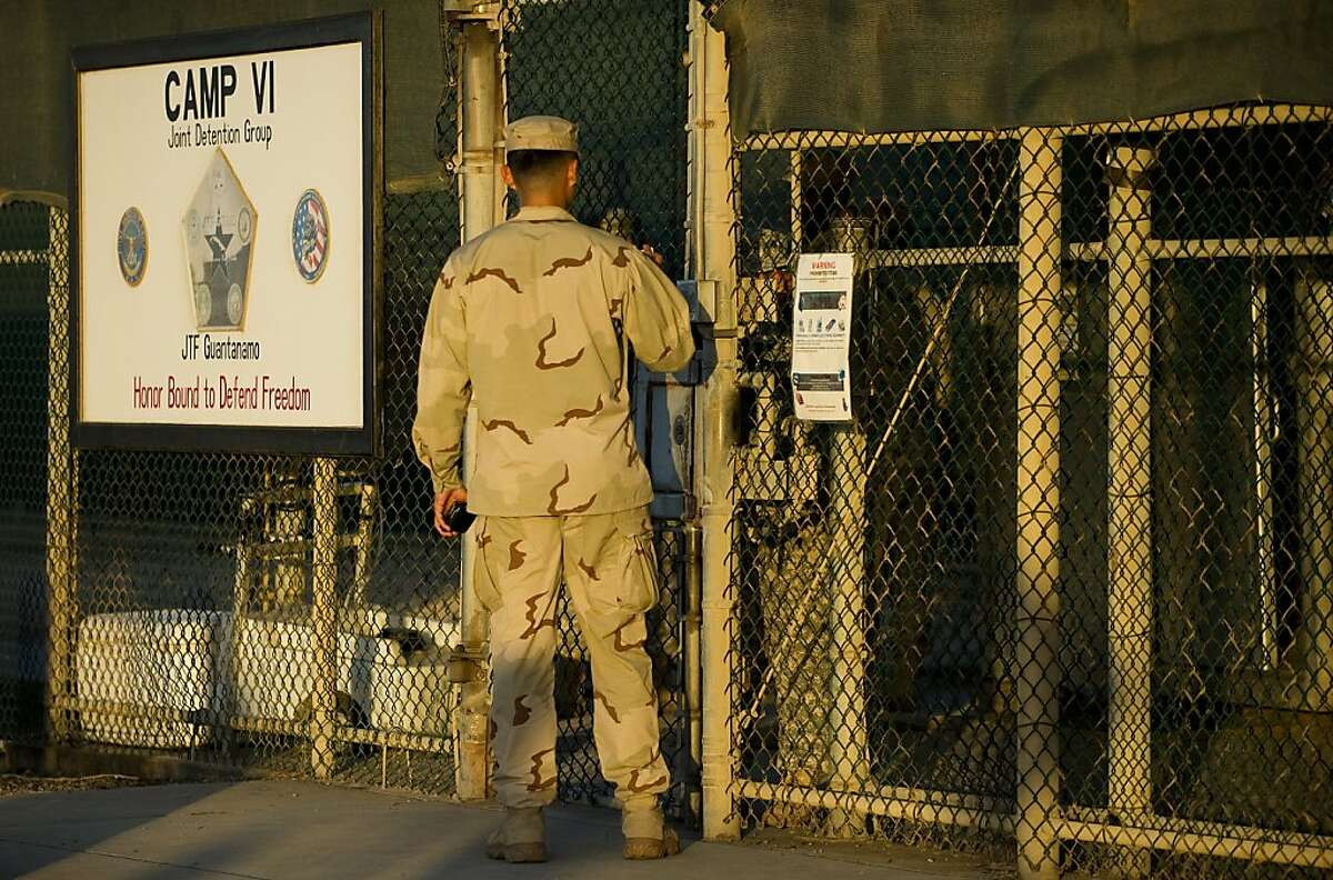 This image reviewed by the US military shows a member of the military asking for enterance at the front gate of