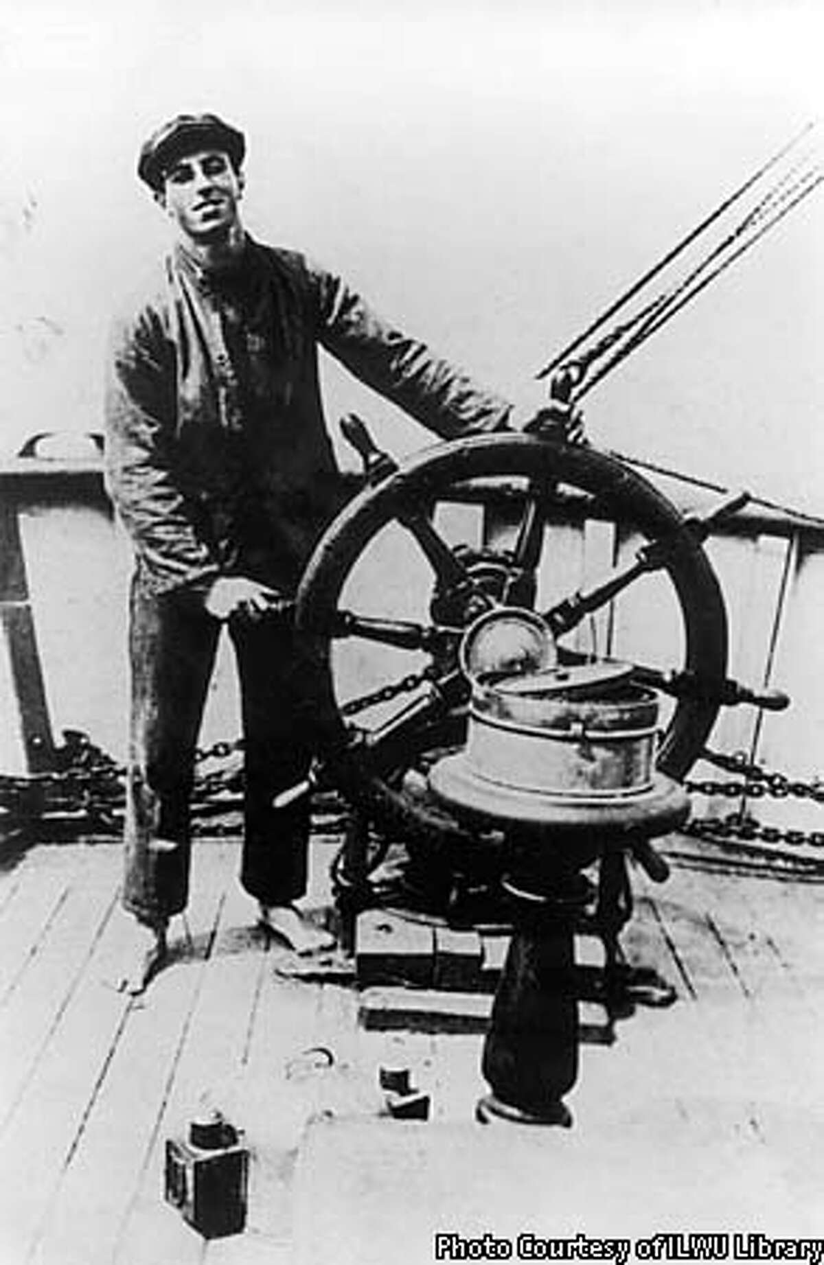 Harry Bridges at the helm of the Santa Ysabel when he first sailed into San Francisco in 1920 as a member of the Australian Seaman's Union. MANDATORY CREDIT: BRIDGES FAMILY PHOTO, COURTESY OF ILWU LIBRARY.