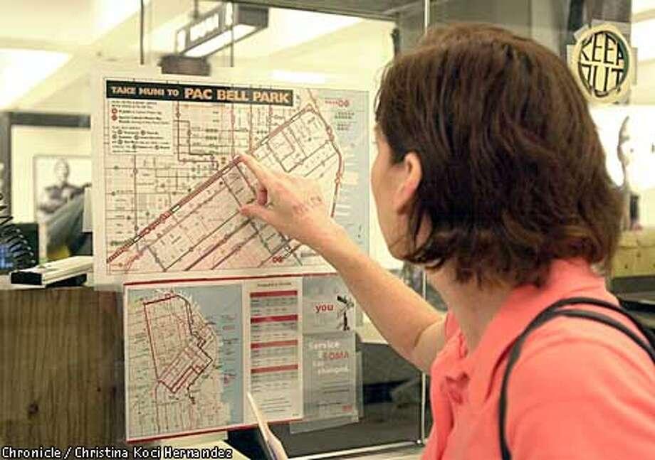Lisa Amorde, visiting San Francisco from Orange County, tried to make sense out of a Muni map.Chronicle photo by Christina Koci Hernandez