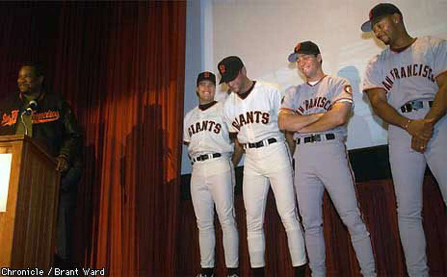 Giants manager Dusty Baker drew a laugh as players (left to right) J.T. Snow, Shawn Estes, Bill Mueller and Ellis Burks modeled the new uniforms the team will wear next season. Chronicle Photo by Brant Ward