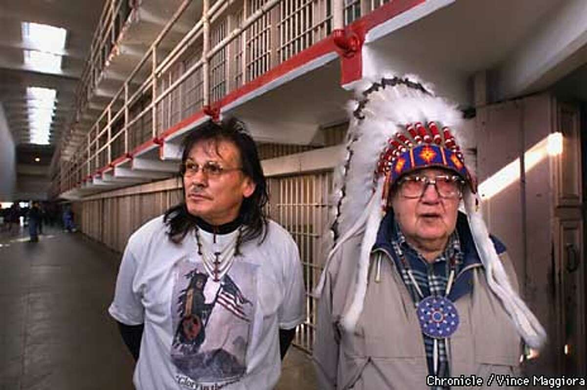 L TO R Gary Hodge and Indian Joe Morris occupied Alcatraz 30 years ago Joe now sells one of his books to tourists on Alcatraz Gary and Joe in the main cell block on the island. by Vince Maggiora