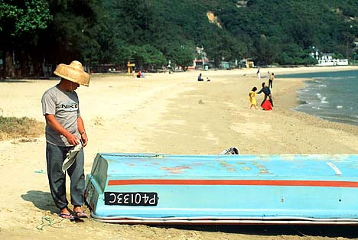 Quiet side: Mui Wo's nearly empty beach is in sharp contrast to Hong Kong's frenetic Central district. Photo by Carl Duncan, special to the Chronicle