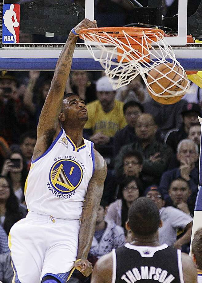 Golden State Warriors' Dorell Wright (1) scores over Sacramento Kings' Jason Thompson during the first half of an NBA basketball game, Tuesday, Jan. 31, 2012, in Oakland, Calif. (AP Photo/Ben Margot) Photo: Ben Margot, Associated Press