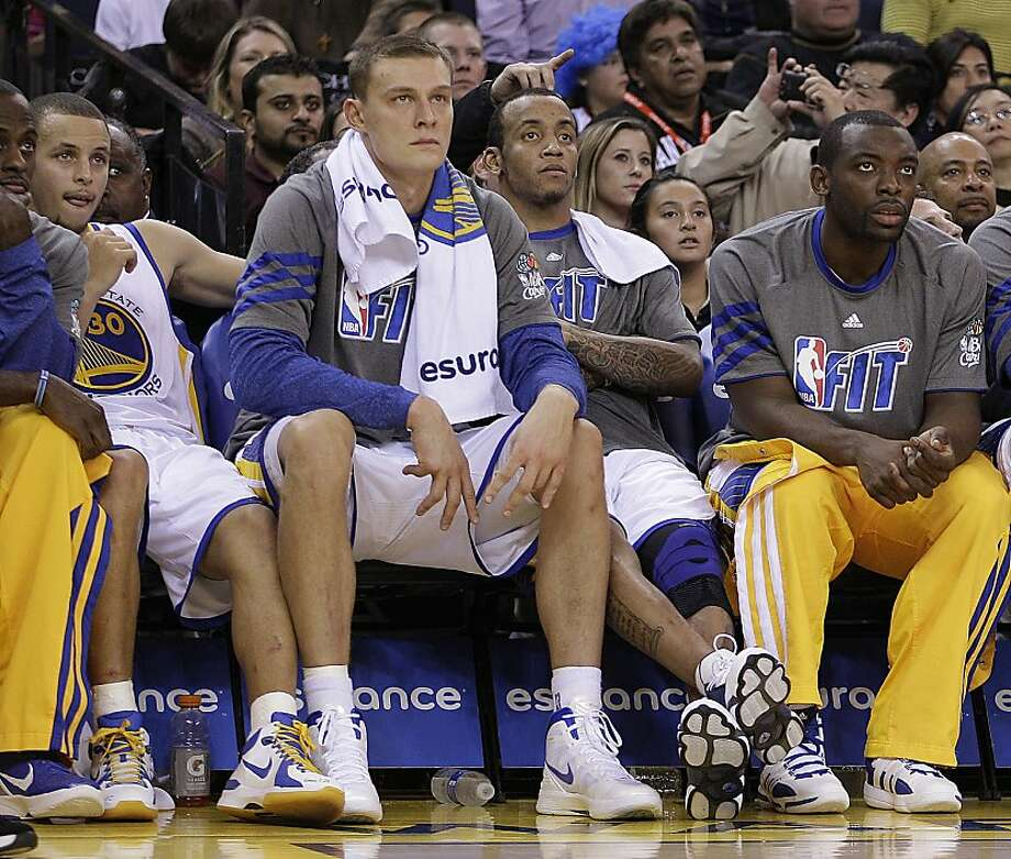 Golden State Warriors starters, from left, Stephen Curry (30), Andris Biedrins, Monta Ellis, and rookie Charles Jenkins watch from the bench during the second half of an NBA basketball game against the Sacramento Kings Tuesday, Jan. 31, 2012, in Oakland, Calif. (AP Photo/Ben Margot) Photo: Ben Margot, Associated Press