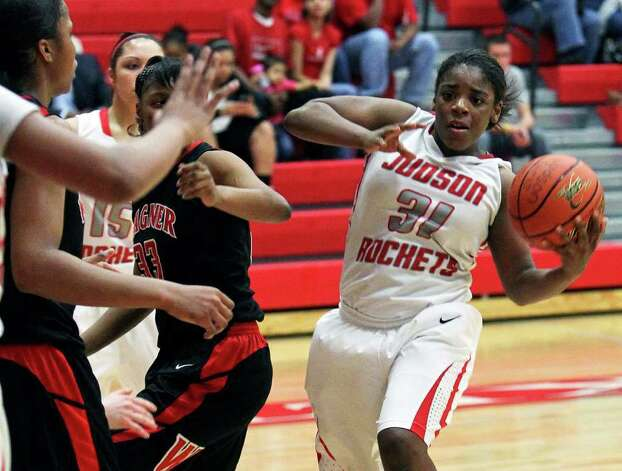 Judson's Breanna Thomas passes in the lane as Wagner plays the Rockets at Judson Gym on Tuesday, Jan. 31, 2012. Photo: Tom Reel,  Treel@express-news.net / treel@express-news.net