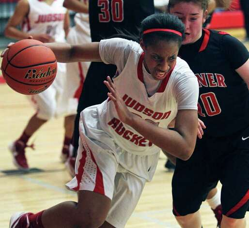 Simone Fields turns away to start Judson's fast break after a rebound as Wagner plays the Rockets at Judson Gym on Tuesday, Jan. 31, 2012. Photo: Tom Reel,  Treel@express-news.net / treel@express-news.net