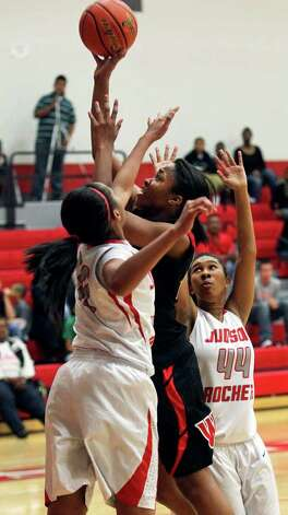 Wagner post Tesha Smith shoots against Judson's Simone Fields and Olivia Lott (44)  as the T-birds play the Rockets at Judson Gym on Tuesday, Jan. 31, 2012. Photo: Tom Reel,  Treel@express-news.net / treel@express-news.net
