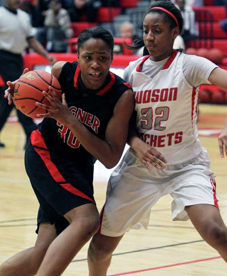 Thunderbirds post Tesha Smith moves against the Rocket's Simone Fields as Wagner plays Judson at Judson Gym on Tuesday, Jan. 31, 2012. Photo: Tom Reel,  Treel@express-news.net / treel@express-news.net