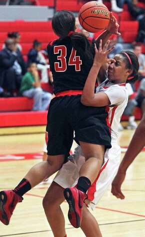 Wagner's Ashley Dunn slams into Judson's Simone Fields in the second half as the Thunderbirds ramp up defensive pressure to defeat the Rockets 43-35 at Judson Gym on Tuesday, Jan. 31, 2012. Photo: Tom Reel,  Treel@express-news.net / treel@express-news.net