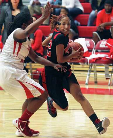Wagner guard Andrea Davis breaks to the basket as the T-birds play Judson at Judson Gym on Tuesday, Jan. 31, 2012. Photo: Tom Reel,  Treel@express-news.net / treel@express-news.net