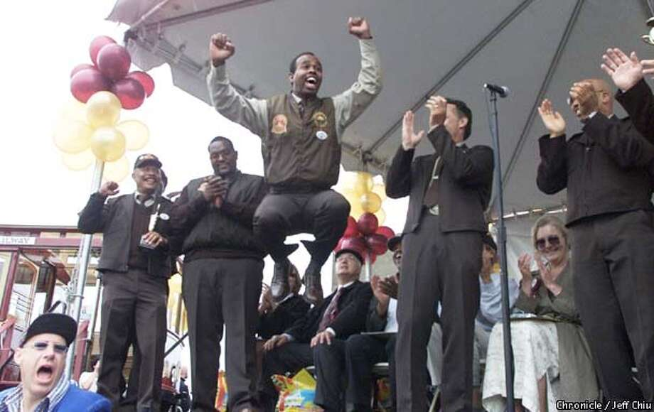 Byron Cobb jumps for joy after being announced as the winner of the 38th Annual Cable Car Bell Ringing Contest Finalists Professional Category at Fisherman's Wharf in San Francisco on Thursday afternoon. Cobb has been with MUNI Cable Car for 12 years, and is a former winner as well. Photo by Jeff Chiu / The Chronicle. Photo: Jeff Chiu