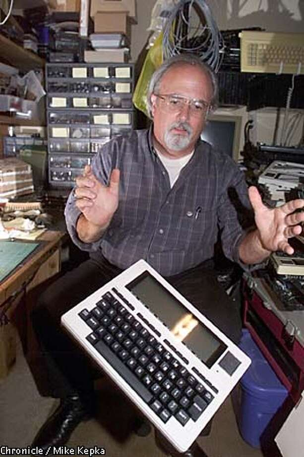 Rick Hanson of Pleasant Hill dropped a TRS-80 on the floor to demonstrate its toughness. Chronicle photo by Mike Kepka