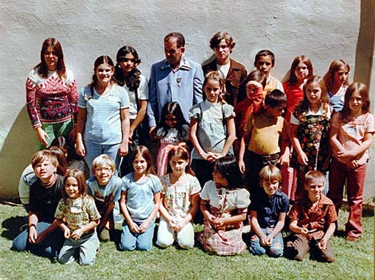 A group photo shows the 26 children and the school bus driver who were kidnapped from Chowchilla, gathered for