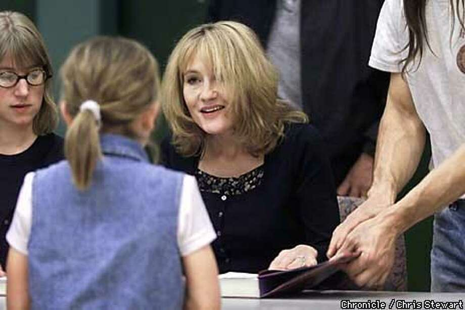 JK Rowling, Scottish author of the hugely popular Harry Potter book series, signs autographs at Maria Carrillo High School, 6975 Montecito Blvd., Santa Rosa. A line formed well before the 6 pm event, and the crowd was herded into the school gymnasium/auditorium where Rowling read briefly from the latest book before signing thousands of autographs with a quick, squiggly flourish. SAN FRANCISCO CHRONICLE PHOTO BY CHRIS STEWART Photo: CHRIS STEWART