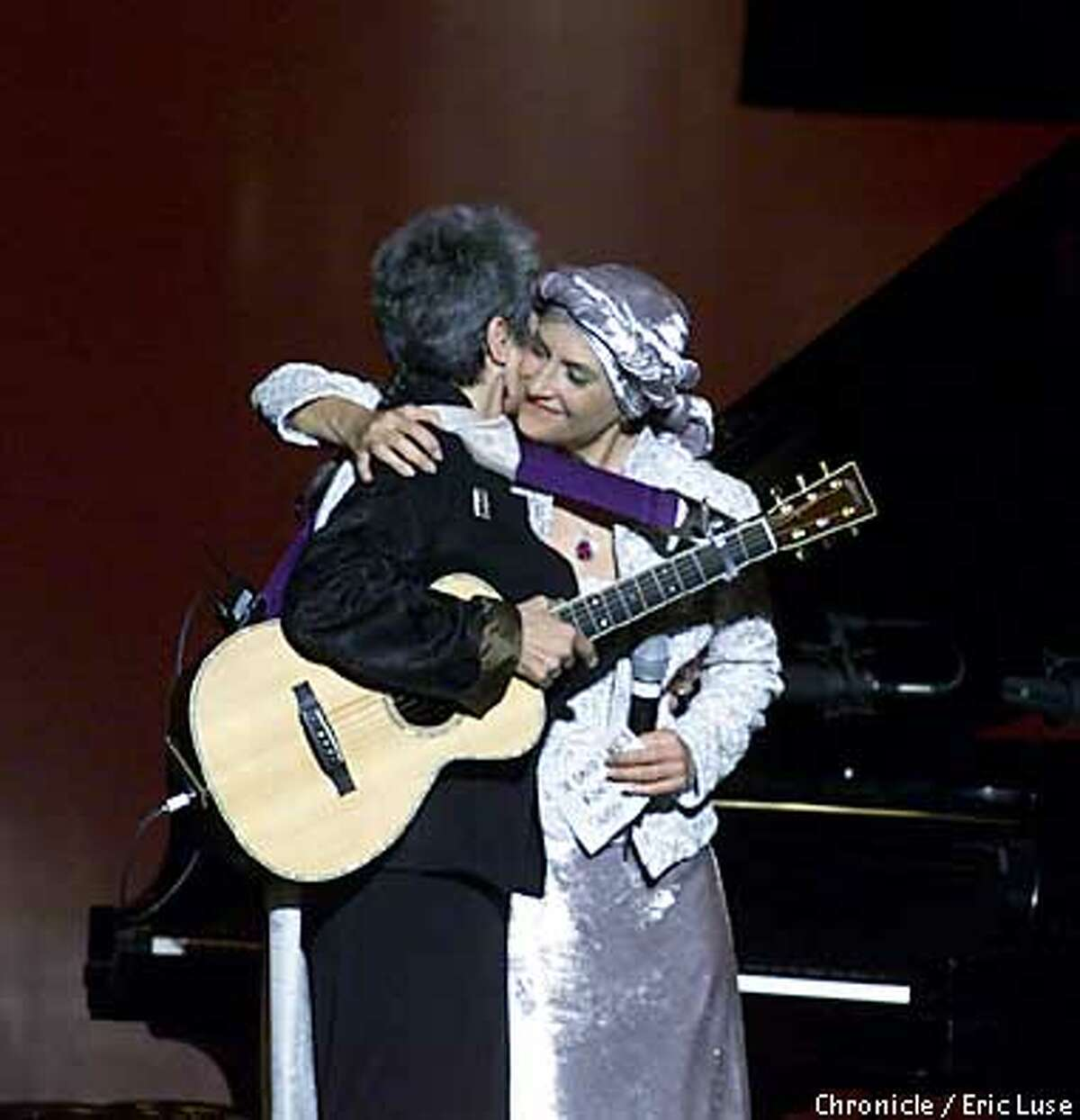 Joan Baez and her sister Mimi Farina embraced at the Bread and Roses Concert at the War Memorial Opera House,SF. BY ERIC LUSE/THE CHRONICLE