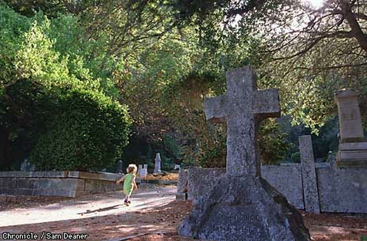 """Althea Stone, 1, skips through Evergreen Historic Cemetery in Santa Cruz chasing after her mother Anyssa. Anysssa said she and her daughter use the cemetery as a peaceful place for calisthenics. """"She goes up and down--plays in he leaves. It's peaceful and she likes it better than parks"""", said Anyssa. CHRONICLE PHOTO SAM DEANER"""