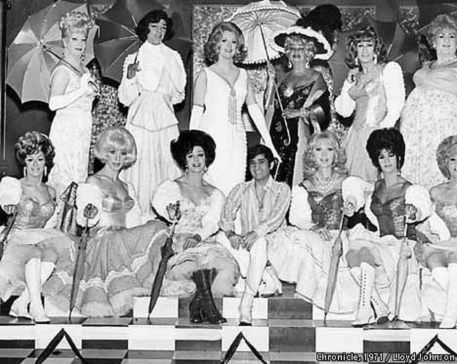 Turned out in dresses, wigs and parasols, the cast of Finocchio's as it appeared in its heyday at the club on Broadway. Chronicle Photo 1971 by Lloyd Johnson