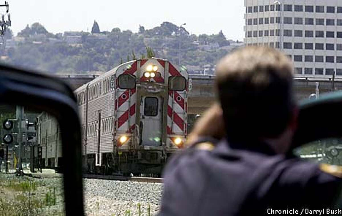 An officer patrolling the railroad tracks in San Mateo as part of
