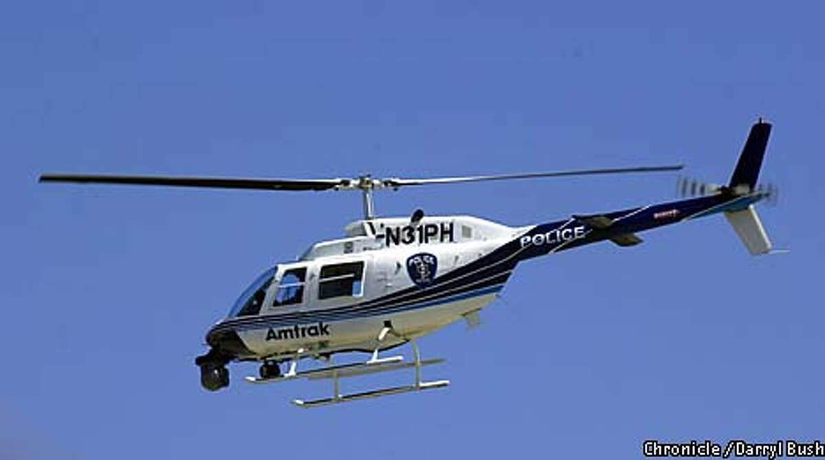 Amtrak police took to the skies in a helicopter to watch from above for trespassers on the right of way. Chronicle photo by Darryl Bush