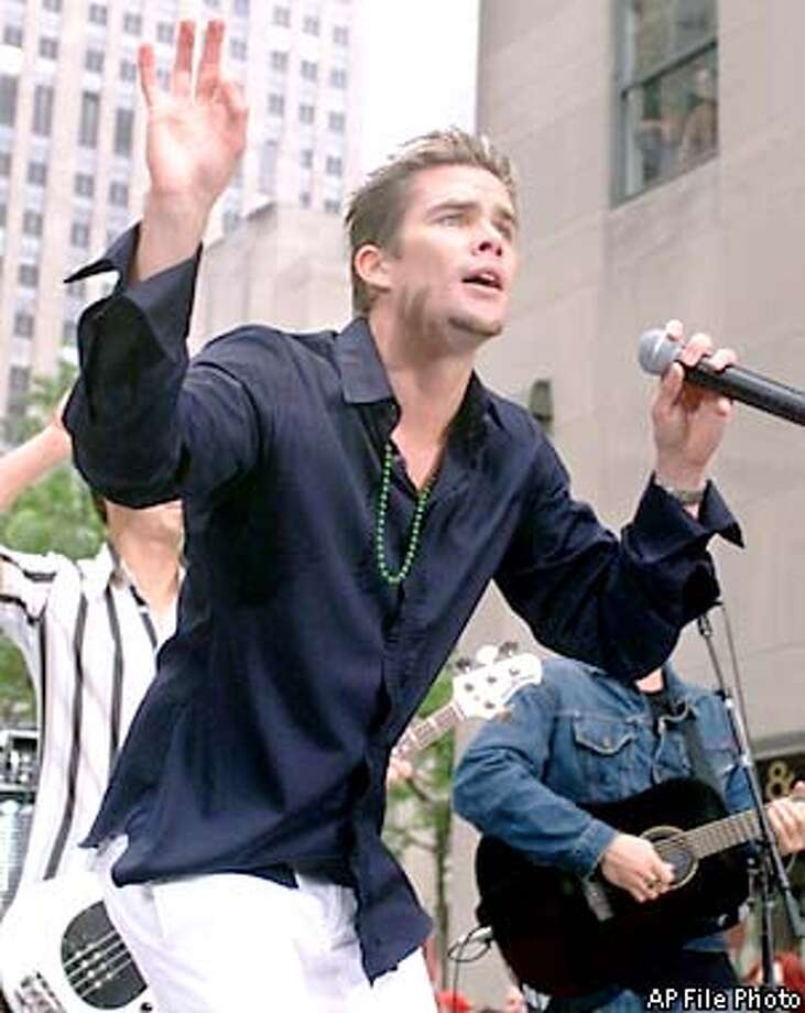 "Mark McGrath, lead singer of Sugar Ray, performs on NBC's ""Today"" show Summer Concert Series, Friday, June 15, 2001, at New York's Rockefeller Center. (AP Photo/Richard Drew) Photo: RICHARD DREW"
