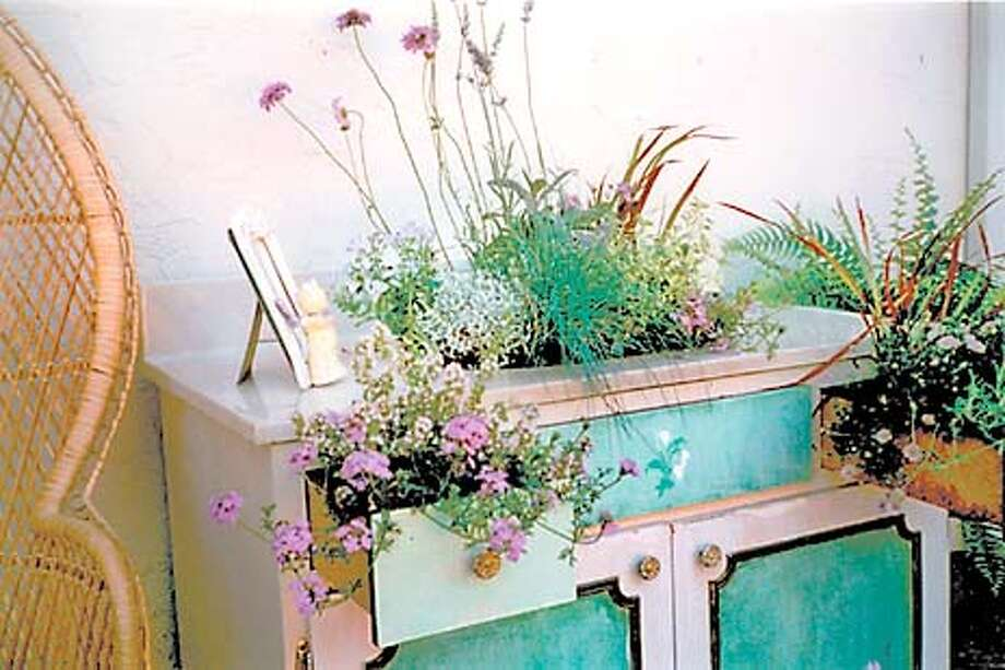 Flowers In Vain: Although she didn't win a magazine design contest, the author has found a colorful use for a discarded bathroom vanity and sink. Photo by Sandy Kunz, special to the Chronicle Photo: PROJECT11B-C-10JUL01-HM-HO