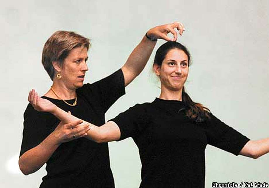 Stage Director, Elizabeth Bachman, has student Naomi Kimmerling, of San Francisco, imagine a string running straight through her body to the top during acting class where they first instructed the girls on a stage entrance and curtsy. SAN FRANCISCO CHRONICLE PHOTO BY KAT WADE Photo: KAT WADE