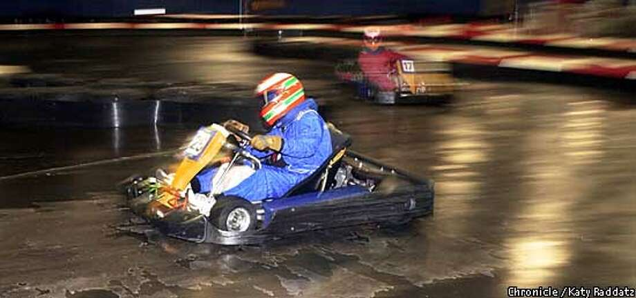 Photo by Katy Raddatz--The Chronicle  Speedring Indoor Kart Racing, 2900 Mead Ave. in Santa Clara. SHOWN: DEBRA PHILLIPS IN #25 ROUNDS A TURN WITH #17 IN HOT PURSUIT. Reporter is Jordan Robertson. Photo: KATY RADDATZ