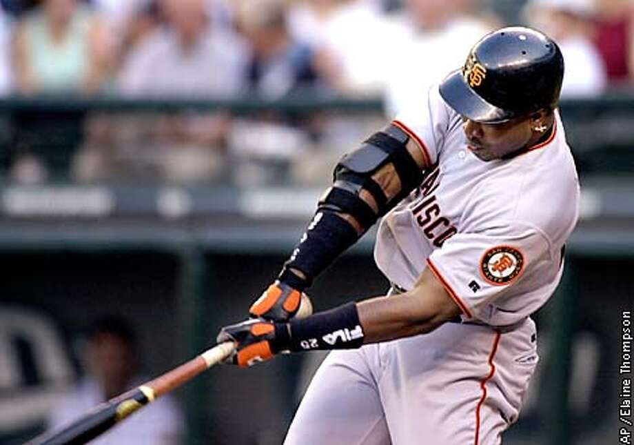 Barry Bonds ended a 13-game, 44-at-bat home-run drought with his first swing of the second half, a solo homer off Seattle's Paul Abbott. Associated Press photo by Elaine Thompson