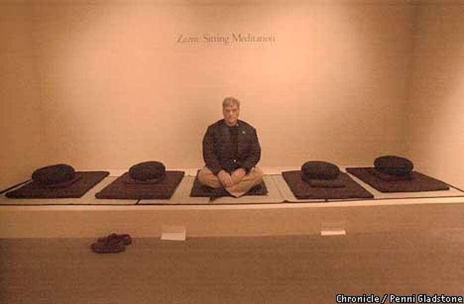 """art collector george gund at the Asian Art museum in SF, sitting at the """"Zazen: Sitting Meditation"""" area within the exhibit. Gund not only owns the san jose sharks but is a big collector of zen art. He lent a couple of dozen to the asian's show of Zen painting and calligraphy. CHRONICLE PHOTO BY PENNI GLADSTONE Photo: Penni Gladstone"""