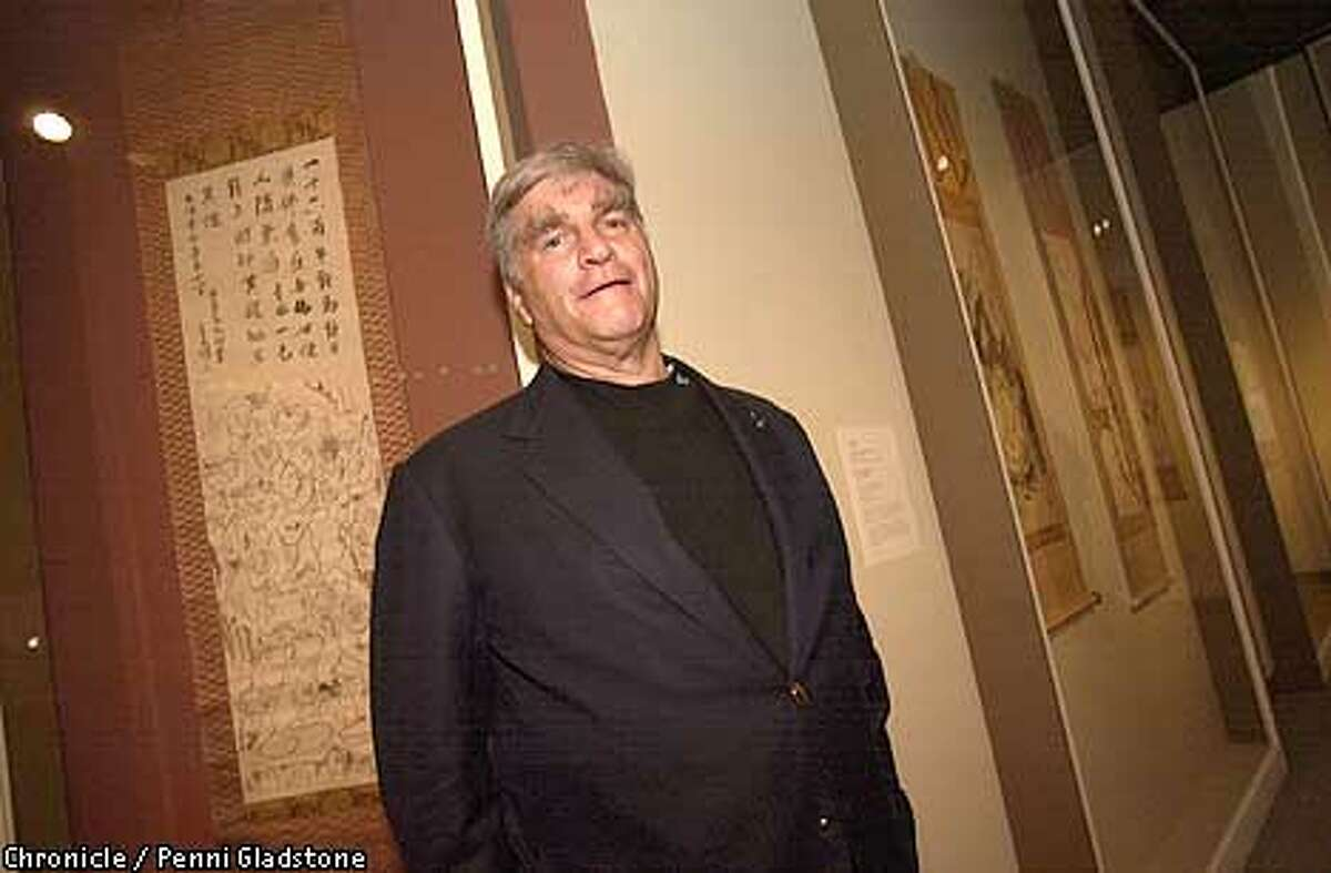 Art collector George Gund at the Asian Art Museum in San Francisco with a painting and calligraphy from his collection.