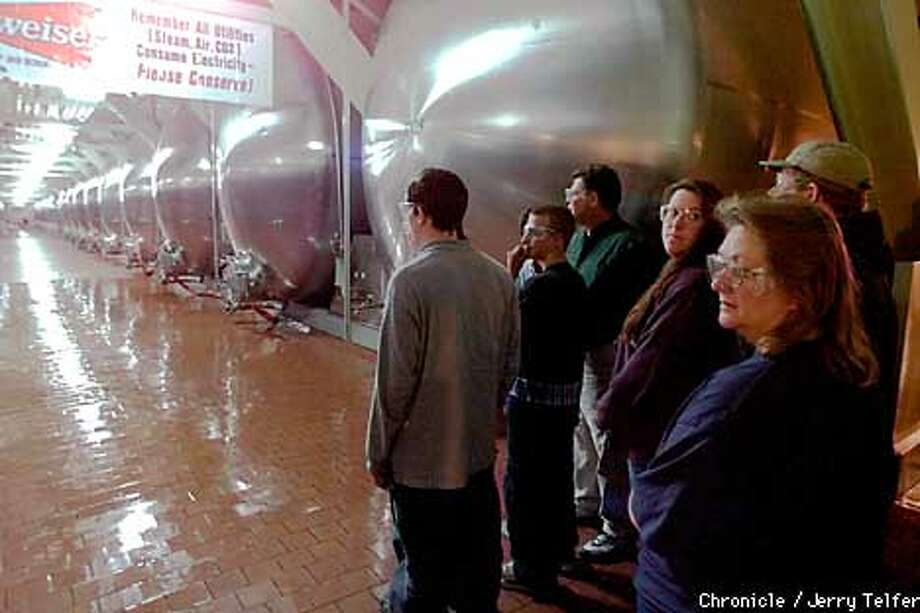 Visitors view a line of lager tanks during a tour of the Budweiser brewery at Fairfield, CA to learn how beer is brewed and bottled. Each of the tanks holds 56,000 gallons, or enough to make 1/2 million 12 oz. cans of beer.  3101 Busch Drive - Fairfield, CA  CHRONICLE STAFF PHOTO BY JERRY TELFER Photo: JERRY TELFER