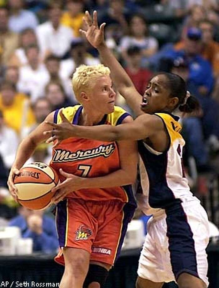 Indiana Fever guard Rita Williams, right, attempts to stop Phoenix Mercury guard Michele Timms during regulation play in Indianapolis on Sunday, July 1, 2001. Indiana won in overtime 86-78. (AP Photo/Seth Rossman) Photo: SETH ROSSMAN