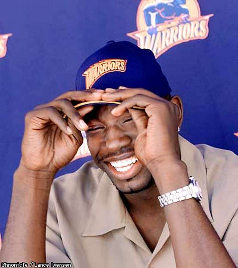 The Golden State Warriors introduced their three draft picks thursday at a press conferance held at Oakland's City Center plaza. Jason Richardson, puts on his new team hat while answering questions from the media. By LANCE IVERSEN/SAN FRANCISCO CHRONICLE Photo: LANCE IVERSEN