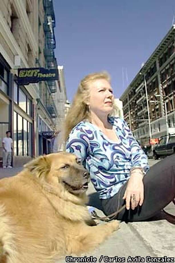 Exit Theater director, Christine Augello with her dog, Lucy, in front of the theater on the edge of the Tenderloin, on Wednesday, June 12, 2001. (Photo by Carlos Avila Gonzalez/The San Francisco Chronicle) Photo: CARLOS AVILA GONZALEZ