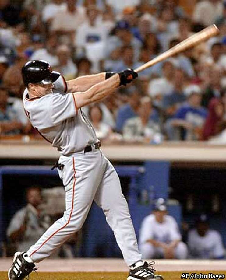 San Francisco Giants' Jeff Kent hits a sixth-inning three-run home run against Los Angeles Dodgers starting pitcher Terry Adams Monday, July 2, 2001, in Los Angeles. (AP Photo/John Hayes) Photo: JOHN HAYES
