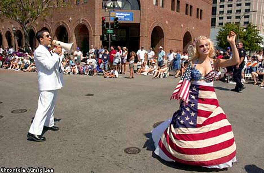 """Fourth of July Parade in Redwood City. Kent Mirkhani annouces the arrival of """"Miss Fourth of July"""" who is Jennie Buss, 18, of Redwood City.  Photo by Craig Lee/San Francisco Chronicle  MANDATORY CREDIT. MAGS OUT. Photo: CRAIG LEE"""