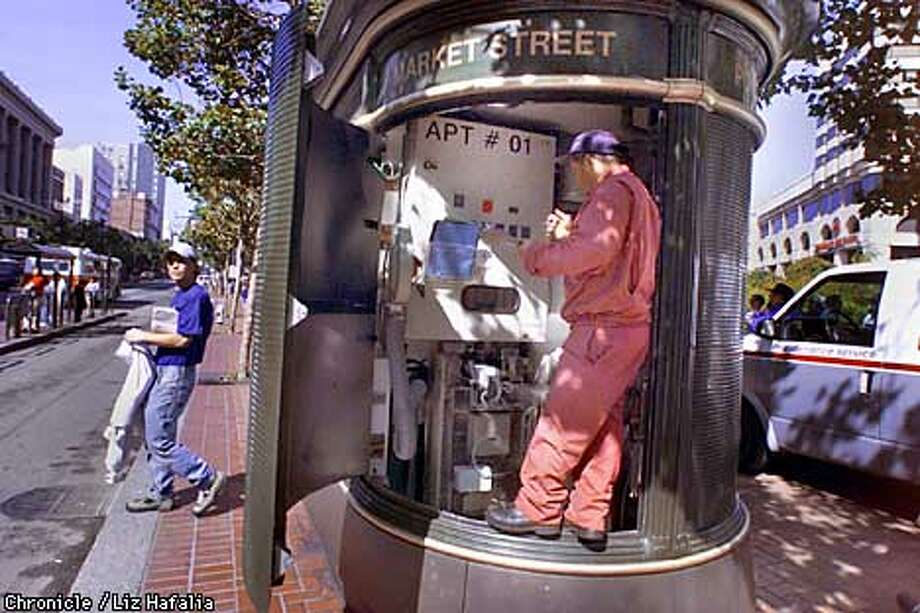 JC DeCaux toilet located on Market at Powell streets being cleaned by maintenance worker.  (BY LIZ HAFALIA/THE SAN FRANCISCO CHRONICLE) Photo: LIZ HAFALIA