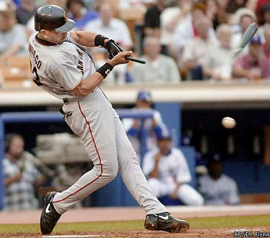 San Francisco Giants' Benito Santiago breaks his bat as he fouls off a pitch during the first inning against the Los Angeles Dodgers in Los Angeles, Tuesday, July 3, 2001. Santiago struck out on the at-bat.(AP Photo/E.J. Flynn) Photo: E.J. FLYNN