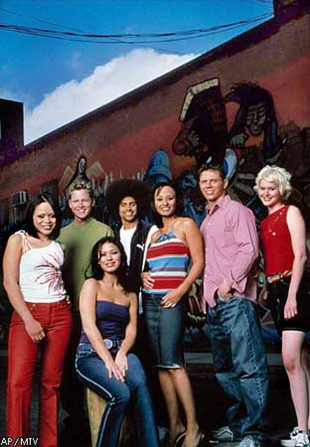 "ADVANCE FOR MONDAY, JULY 2--The new cast of MTV's ""The Real World"" pose together in an undated handout photo. The show that some people see as the granddaddy of the current reality television craze, ""The Real World,"" returns for a 10th season to its first venue --New York--with seven strangers yet again agreeing to live together and have their lives taped. Back row, from left, are: Nicole, Kevin, Malek, Coral, Mike, Rachel. In the Front row is Lori. (AP Photo/MTV, Mando Gonzales) Photo: MANDO GONZALES"