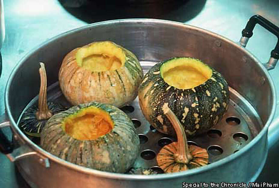 DESSERT: These small kabocha squash are hollowed out, filled with a coconut-milk custard, then steamed. Special to the Chronicle by Mai Pham
