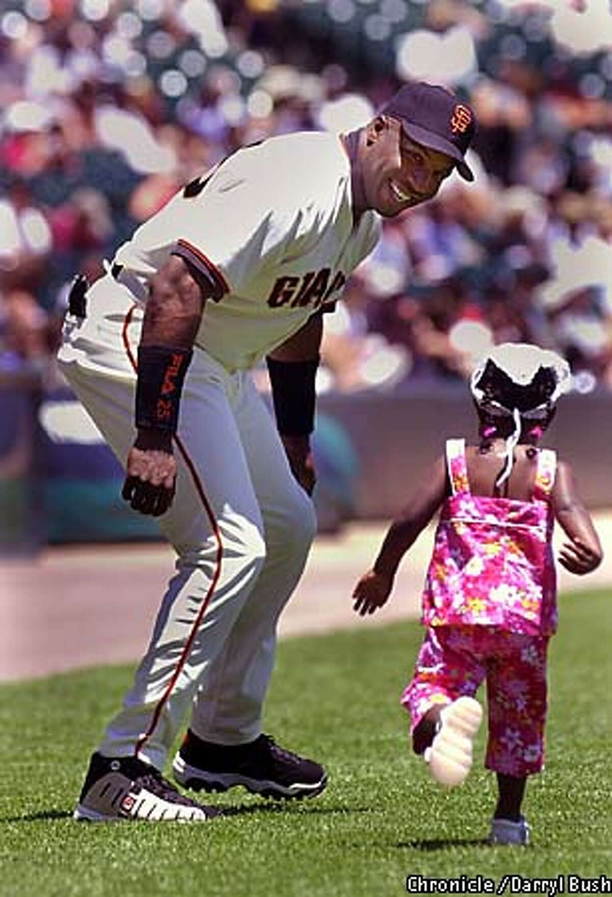 Two-year-old Aisha joined dad, Barry Bonds, on the field for the pregame ceremony for Barry Bonds Day last Sunday. Chronicle photo by Darryl Bush