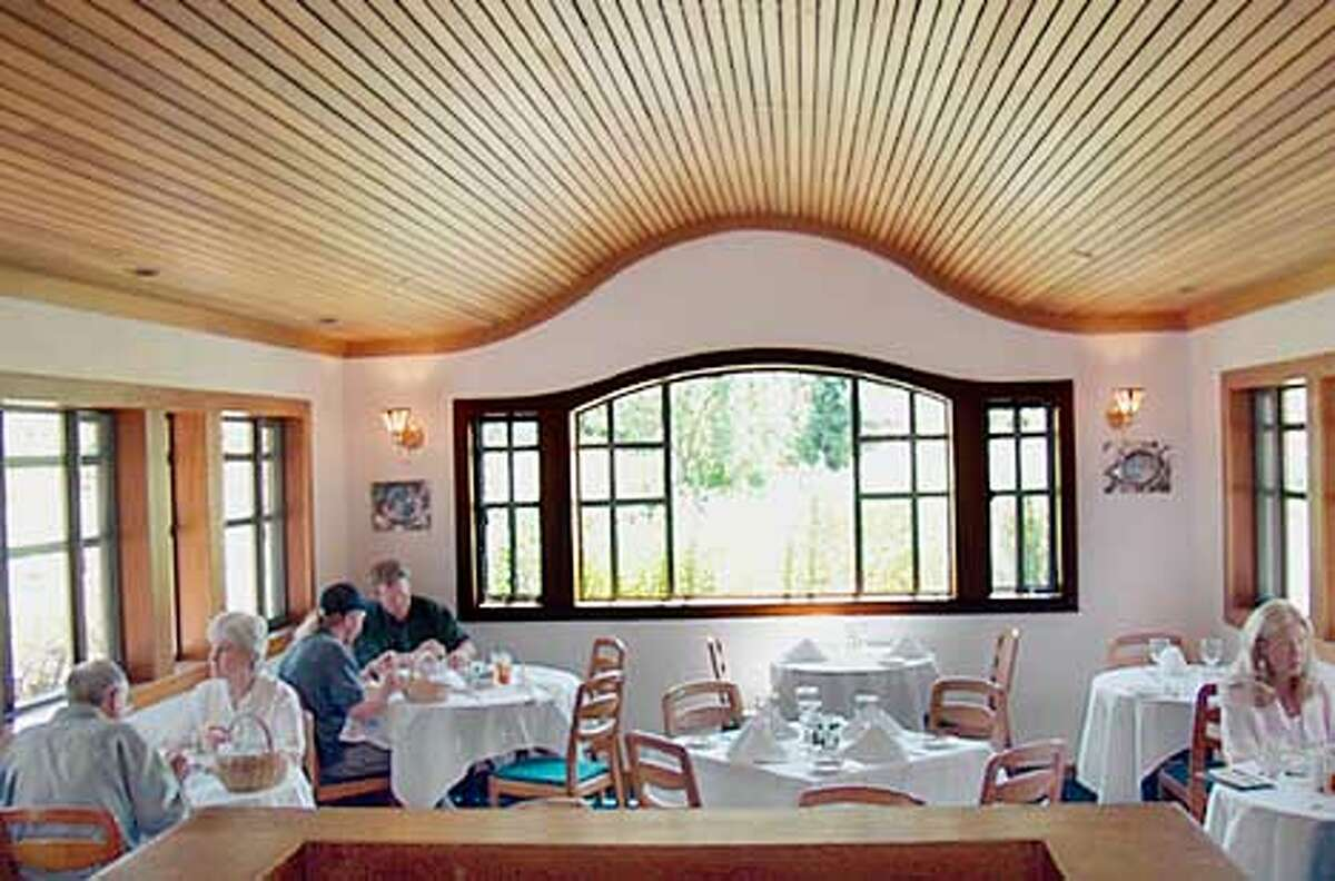 The wavy, slatted red cedar ceiling at Mudd's Restaurant in San Ramon is distinctive and good for absorbing noise, and no table is more than six feet from a window.