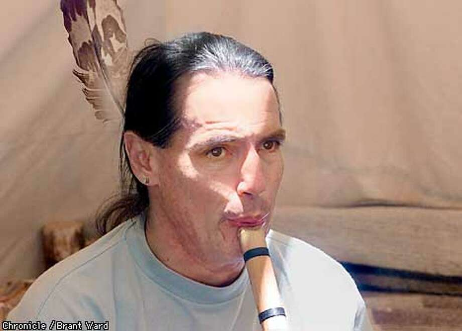 Hal Brightcloud played his wooden flute as he sat in a tipi at the Marin County Home Show and Jazzfest. Brightcloud teaches American Indian arts and crafts throughout the North Bay. By Brant Ward/Chronicle Photo: BRANT WARD