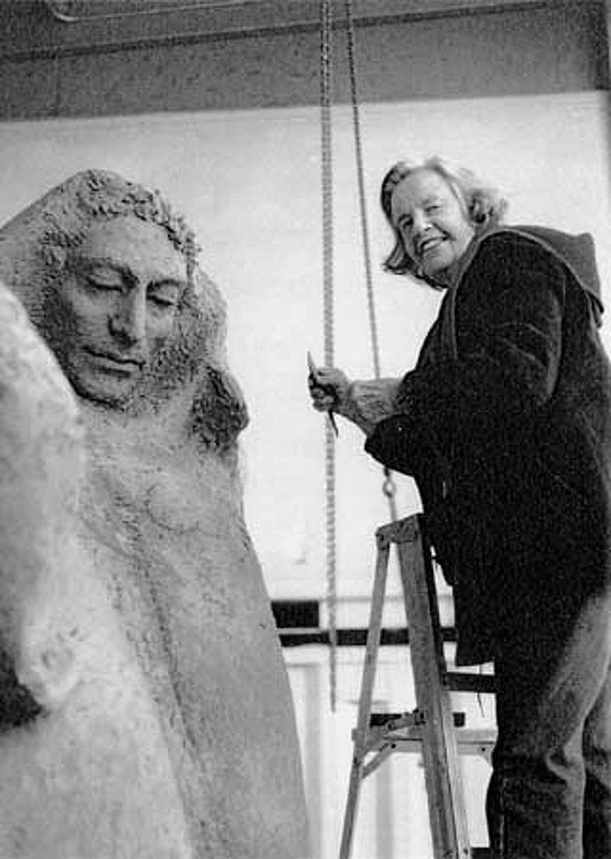 Harriett Moore works on Saint Francis Sculpture.